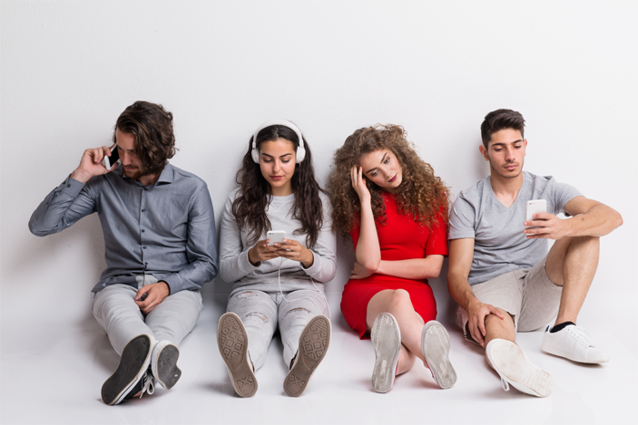 Young group of boys and girls on phone